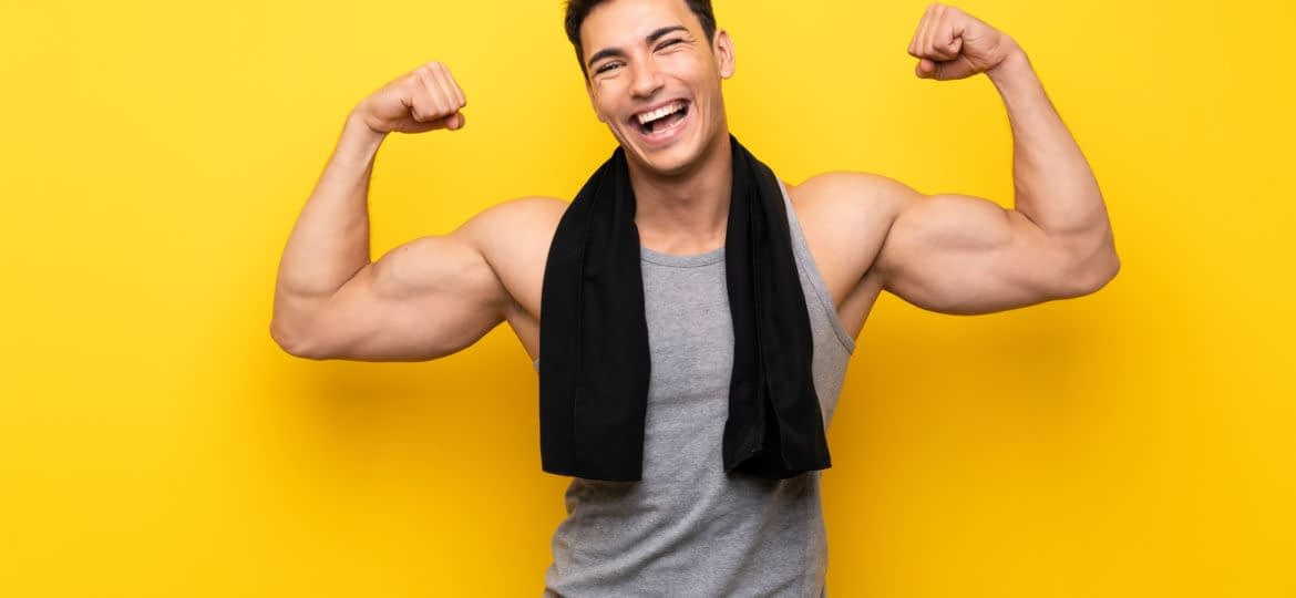 Handsome sport man over isolated background making strong gesture