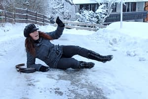 woman falling on an icy driveway