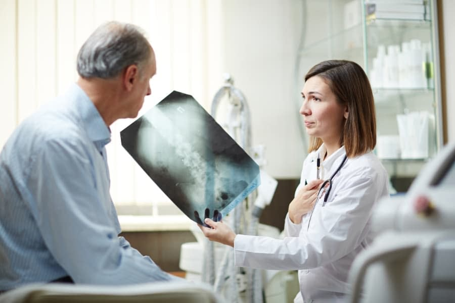 patient showing doctor an x-ray