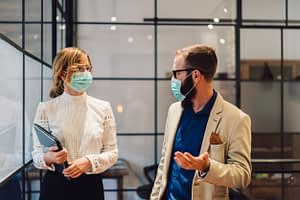 Company employees wearing protective masks at the workplace during Covid-19 outbreak