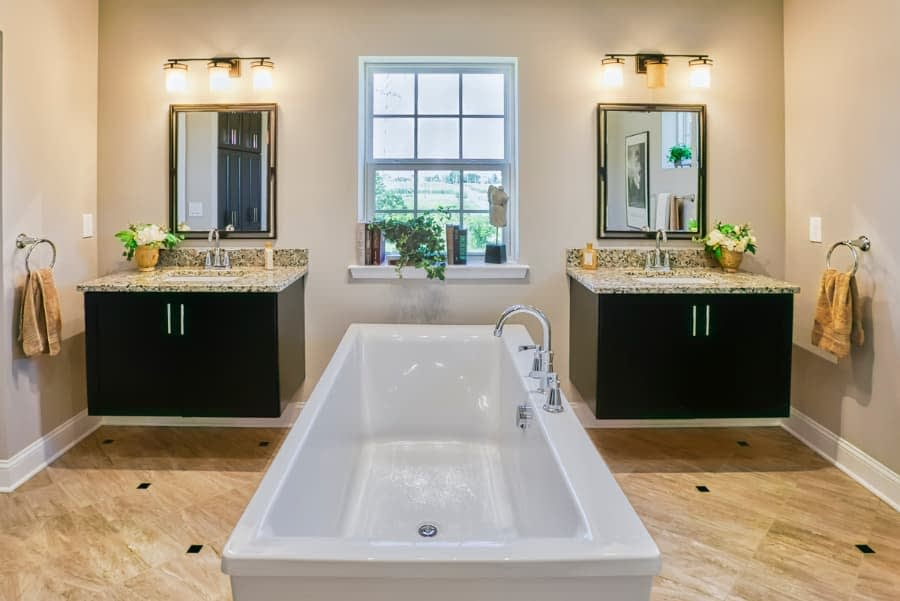 Luxury bathroom with his and her sinks and bathtub