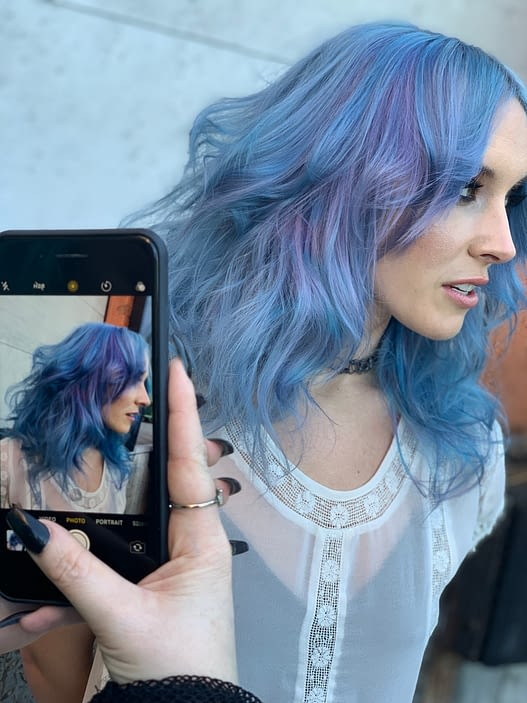 Model with blue Pulp Riot hair color.