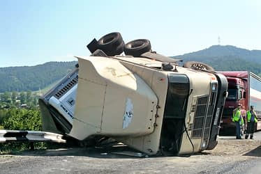 18-wheeler cab flipped on its side on the highway