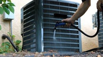 HVAC Technician Working on AC Unit