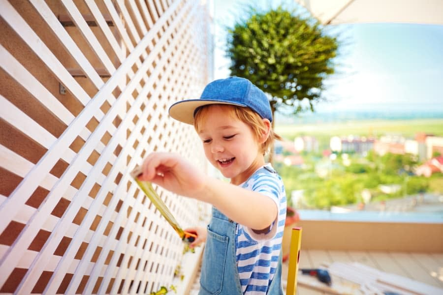 Little Boy Helping with Spring Home Repair