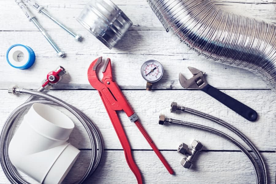 HVAC and Plumbing Tools Laid Out on Table
