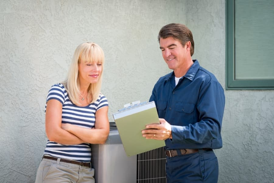 Woman Talking with HVAC Technician