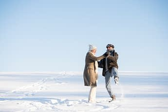 Couple Dancing In The Snow