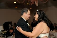 Father and Daughter Dancing at an Event
