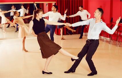 Couples Practicing Swing Dance in Studio
