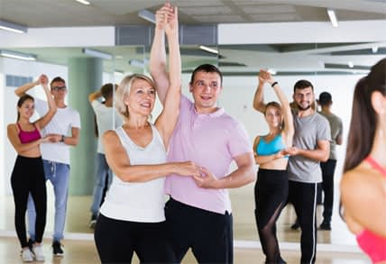 Couples Practicing Ballroom Dance in Studio