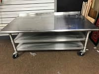 """Pre-Owned Eagle Group 60"""" W Stainless Steel Equipment Stand with (2) Undershelves"""