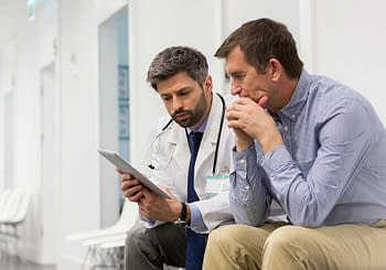 Patient Reviewing Information With Doctor