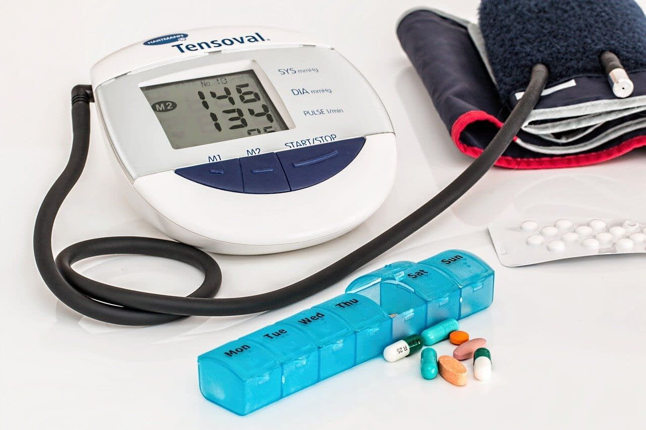 blood pressure machine and pills with pill box