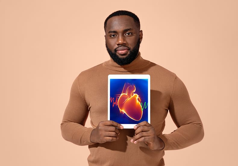Man Showing Image Of Heart.