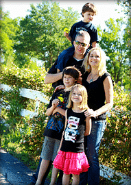 Family of myocarditis patient posing outdoors
