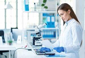 Female Scientist In Medical Lab.