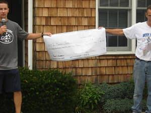 Nathan presenting his fundraising check at the Devin Kravitz Memorial 5K