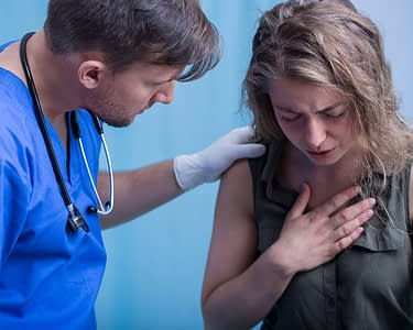 Doctor Tending To Woman
