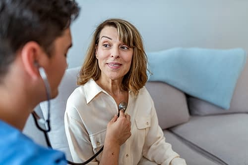 Doctor Checking Patient For Arrhythmias.