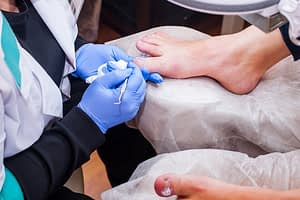 doctor treating foot problems