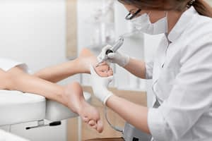 podiatrist working on foot