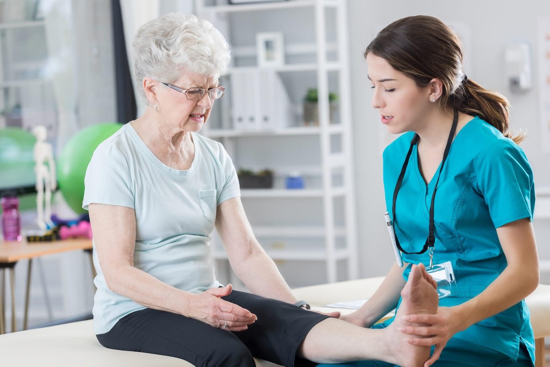 doctor examines patient leg