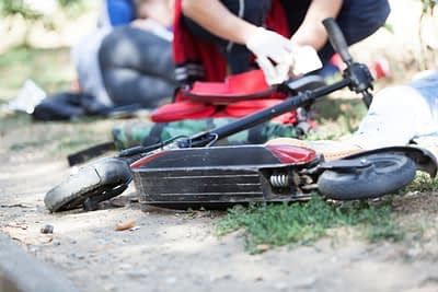 electric scooter lying on side after accident
