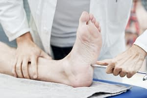doctor testing foot reflex