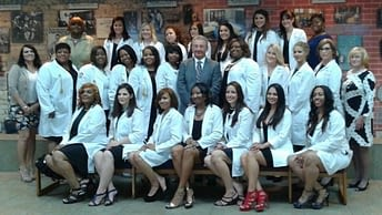 Northwestern College's Violet L. Schumacher School of Nursing Class of 2015, pictured here prior to their Pinning Ceremony with College President Lawrence Schumacher and the Administration & Faculty of the School of Nursing.