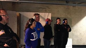 Bridgeview Police Department Investigator Robert Tomiczak looks on along with several Northwestern College Criminal Justice students while touring the department's Firing Range as part of their Criminal Investigations class.