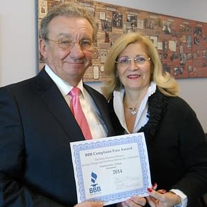 Northwestern College President Lawrence Schumacher and his wife Gail, the College's Executive Vice President, proudly display the College's BBB Complaint Free Award for 2014!