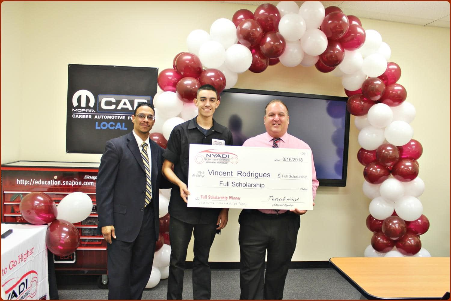 Vincent Rodrigues being presented check for NYADI scholarship