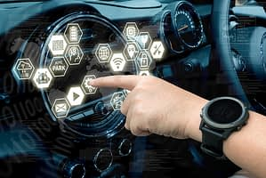Hand pressing virtual buttons on car dashboard