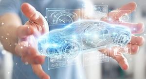 Hands holding virtual representation of car