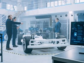 Students and instructor in automotive technology lab