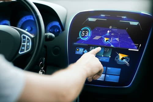 Driver adjusting built-in GPS in car