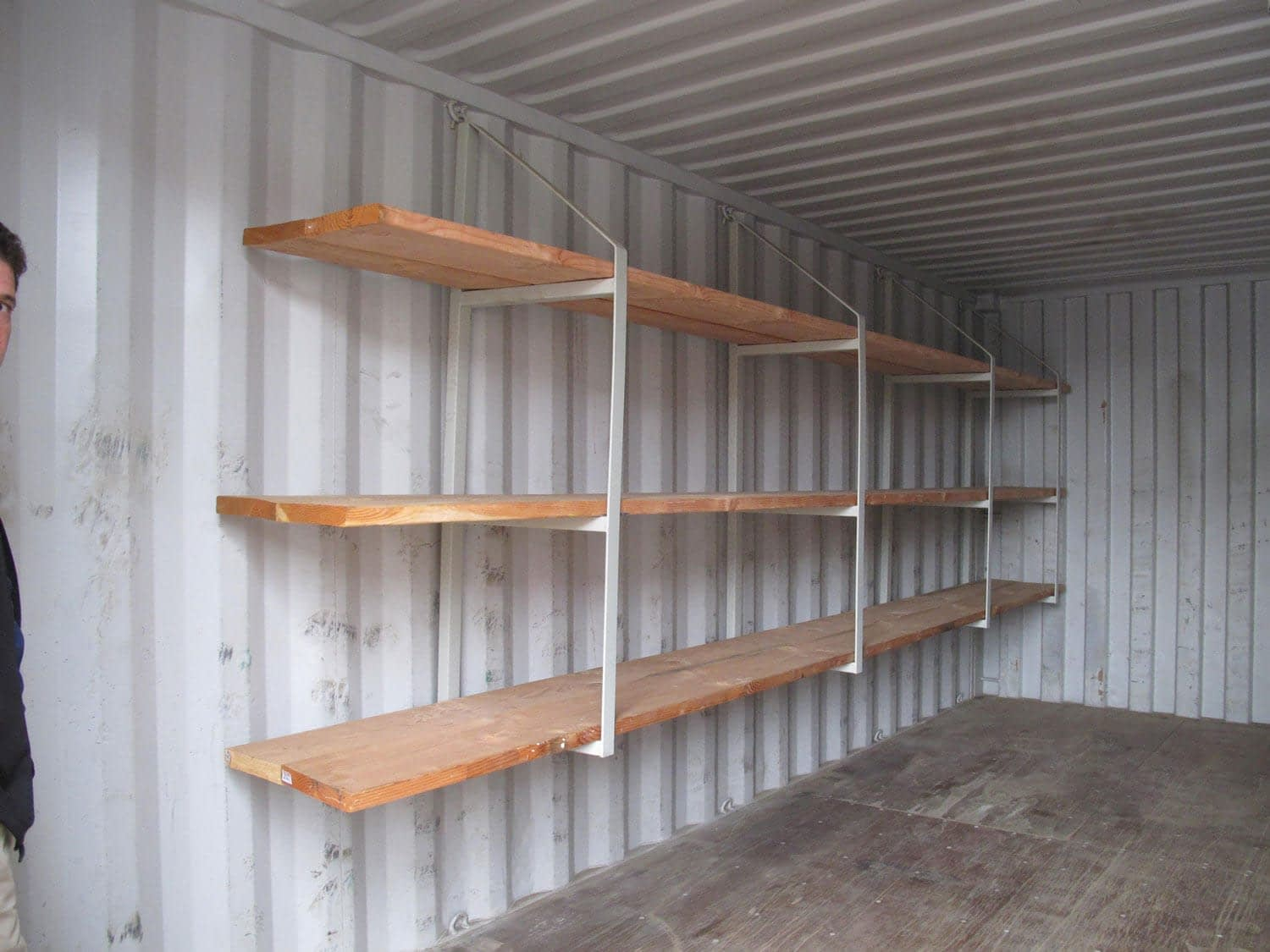 TRS has an economical shelving system that hangs from the D-rings