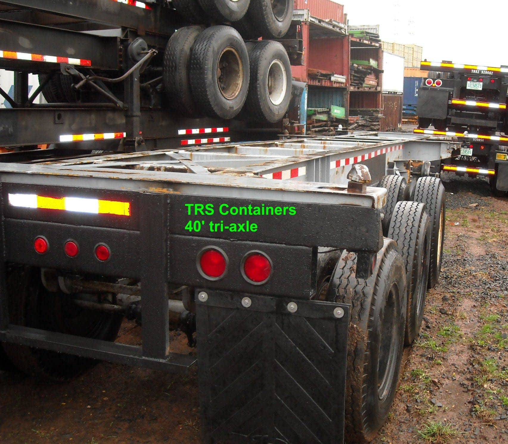 TRS Containers sells rents repairs regsiters stacks and trucks 40 foot tri-axle chassis