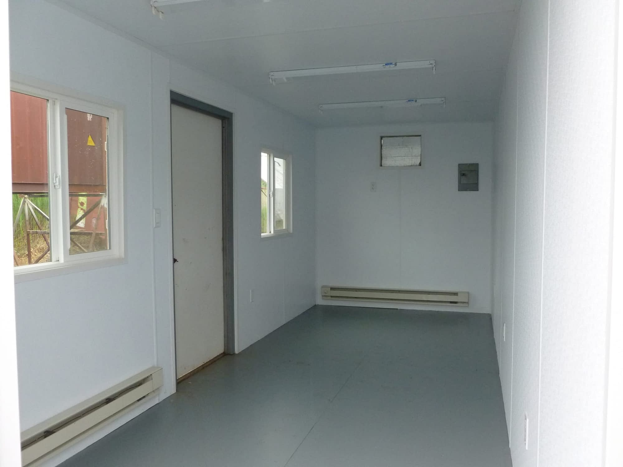 TRS Model 5 office with baseboard heating and painted plywood