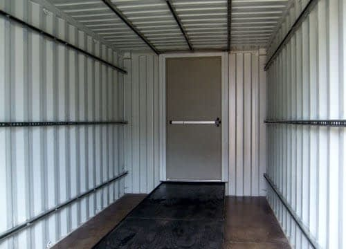 TRS Containers installs steel ramps to roll eqiupment into a steel ISO container for shipping or storage
