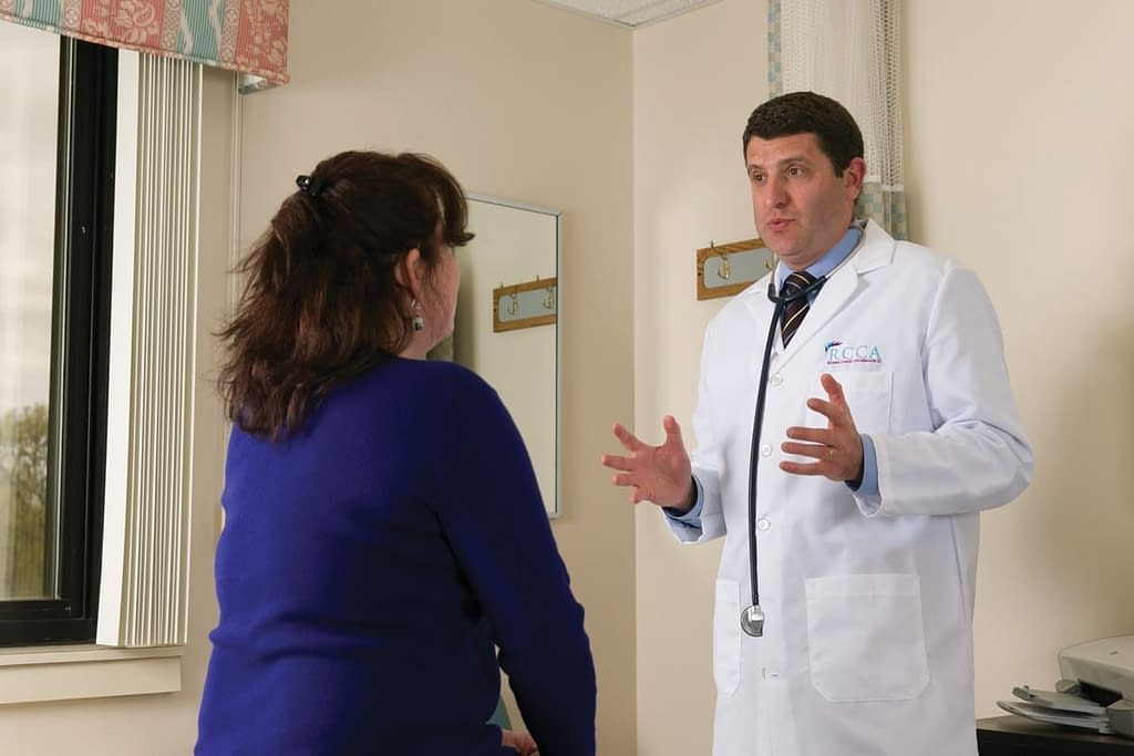 Cancer specialist talking with patient about her results