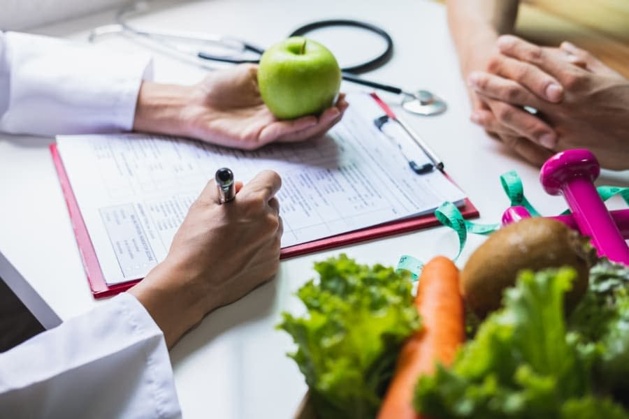 Doctor And Patient With Fruits And Vegetables
