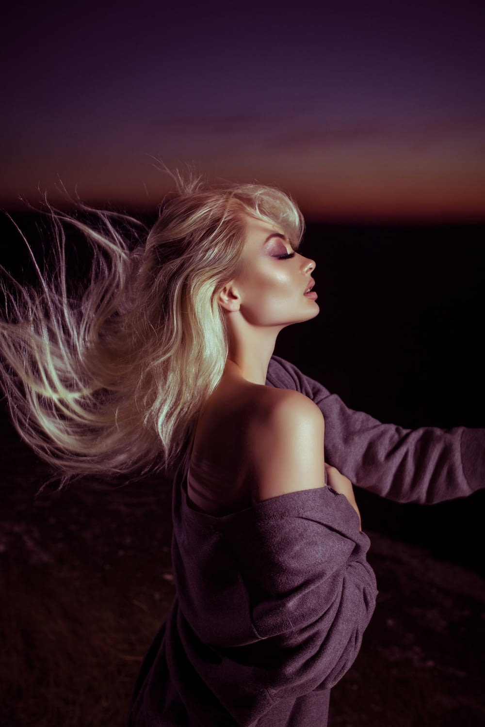 profile of woman with hair blowing behind her