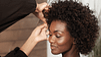 Elegant African American woman getting her hair styled