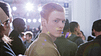Male Aveda model with red hair looking at the camera