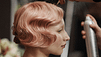 woman with pink hair styled into pin waves
