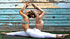 Two woman in pastel colors doing Yoga