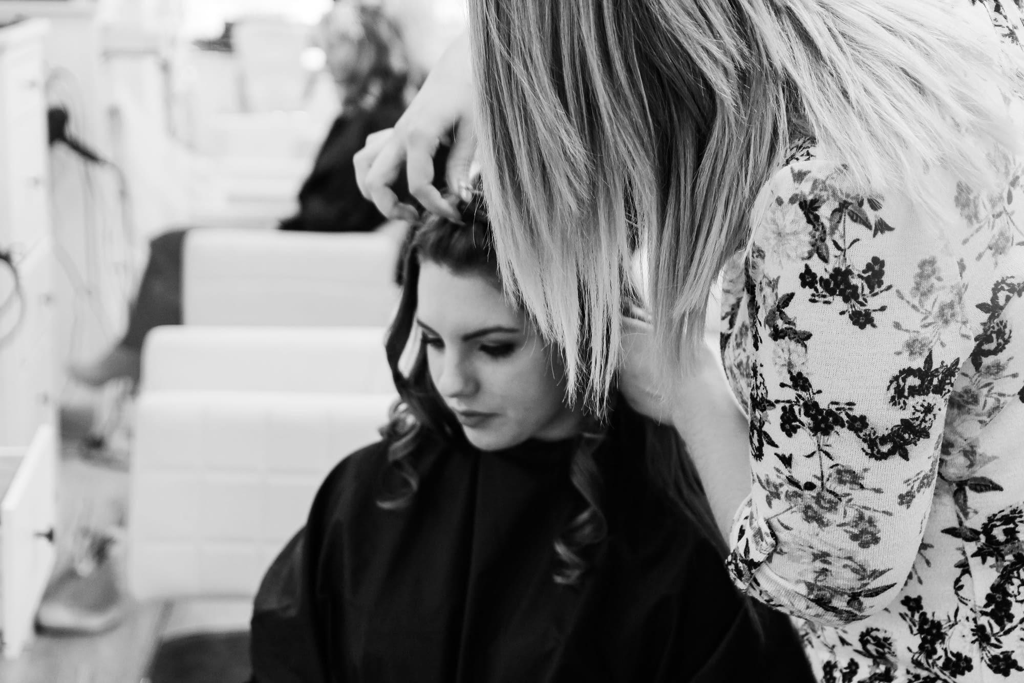 hairstylist doing brides hair