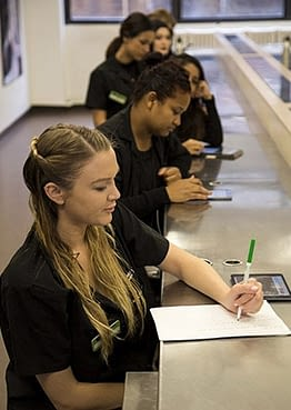 Students studying in class at Aveda Las Vegas